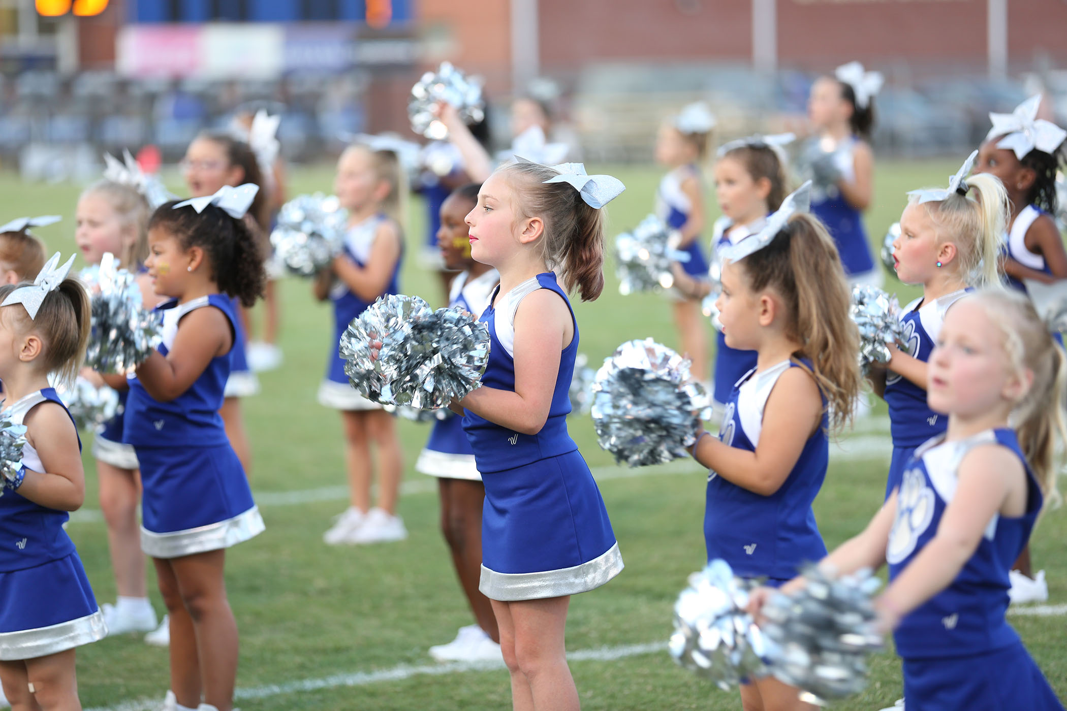 QLE Kittens perform at a football game.