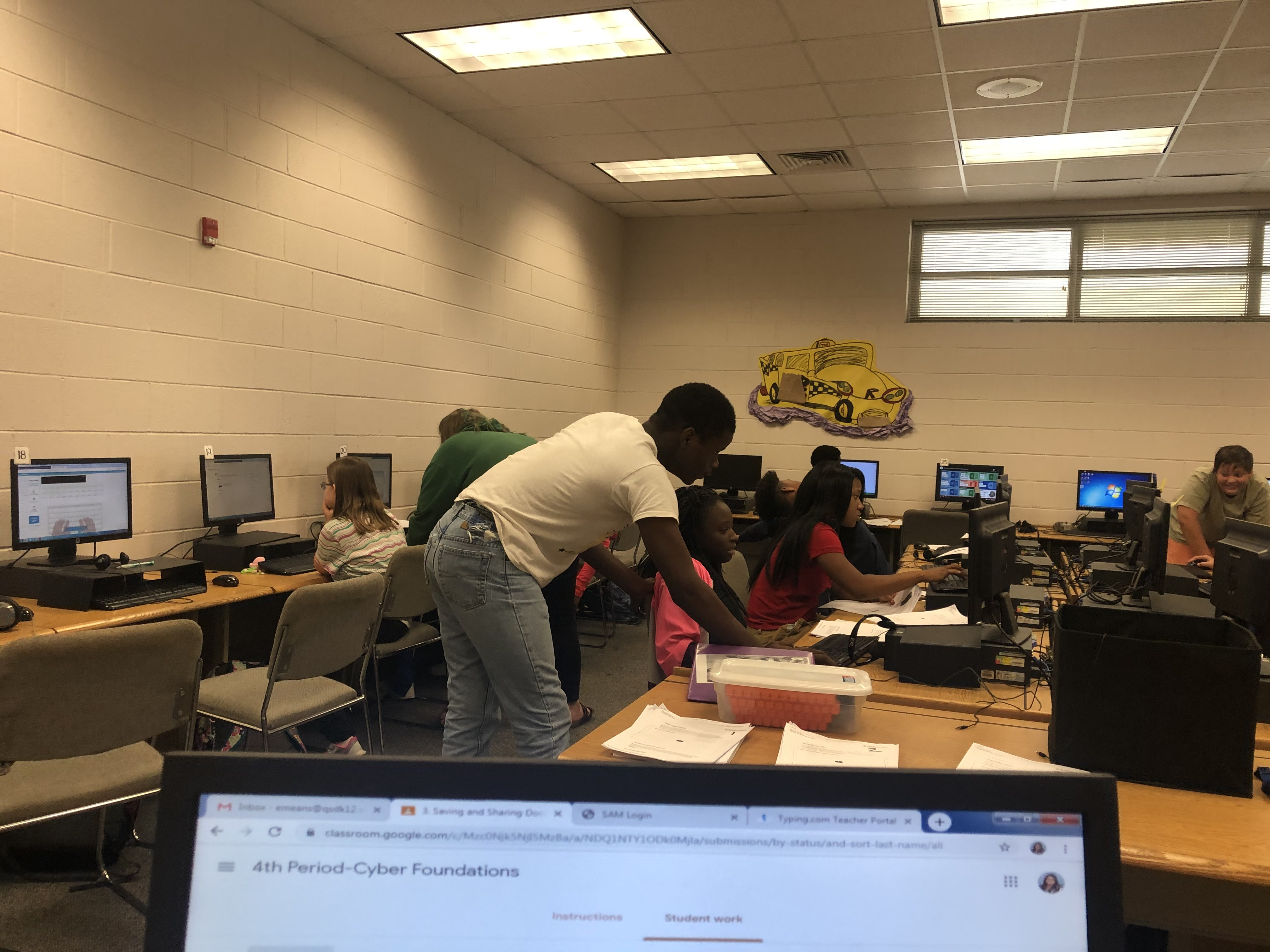 QJH students collaborate on stories in Cyber Foundations class.