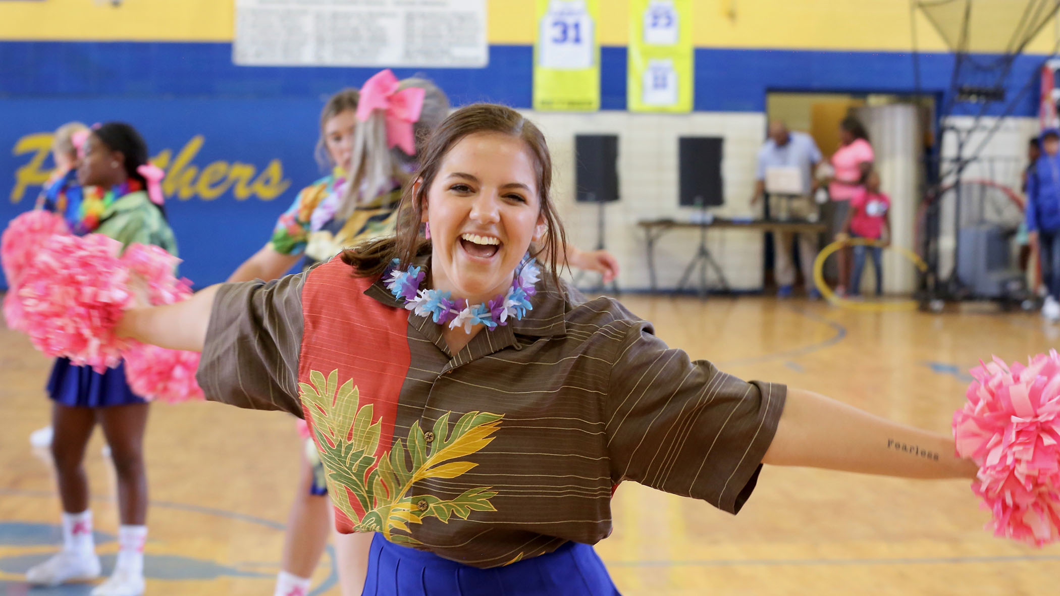 QHS cheerleader gets ready for a pep rally.