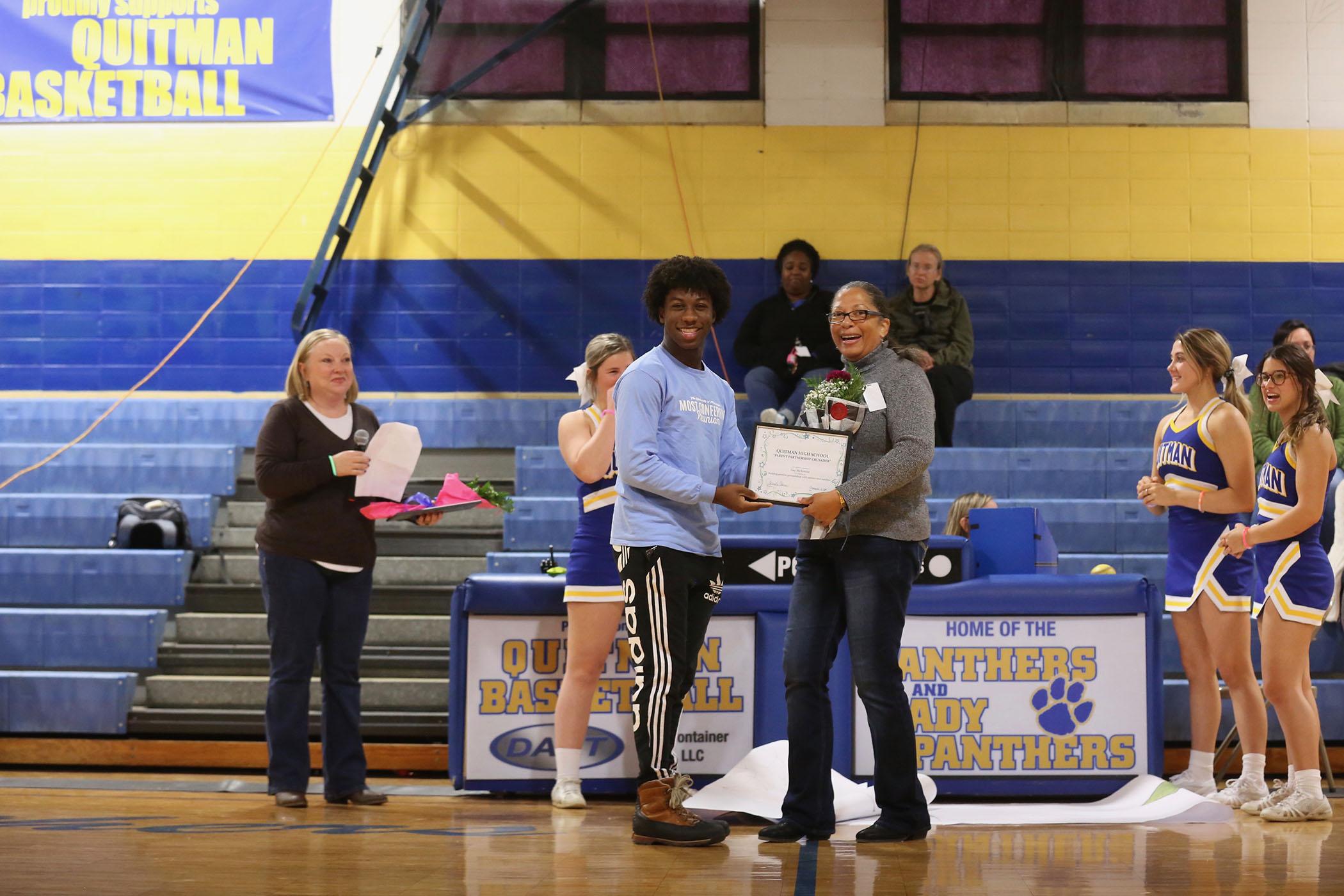 Mrs. McKenzie accepts her award.