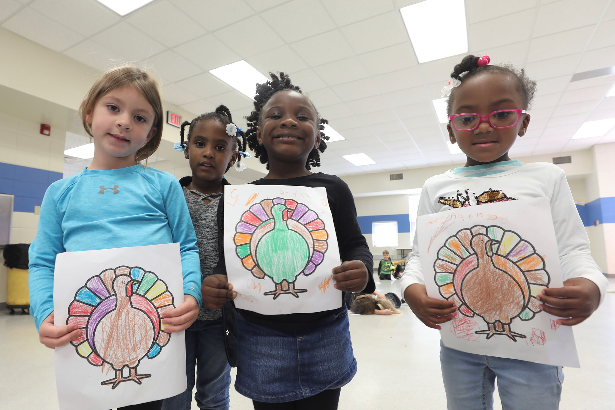 QLE students enjoy coloring sheets in PE.