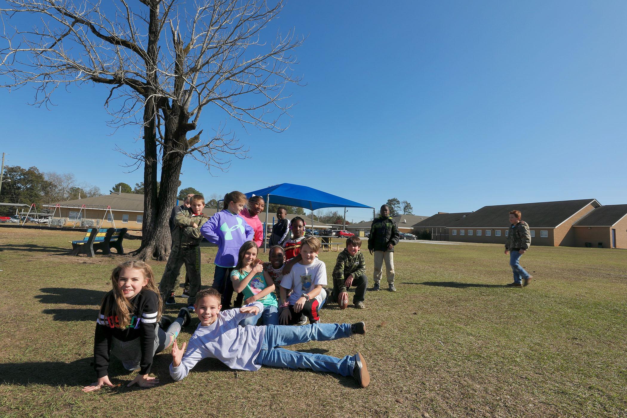 QUE kids enjoy recess.