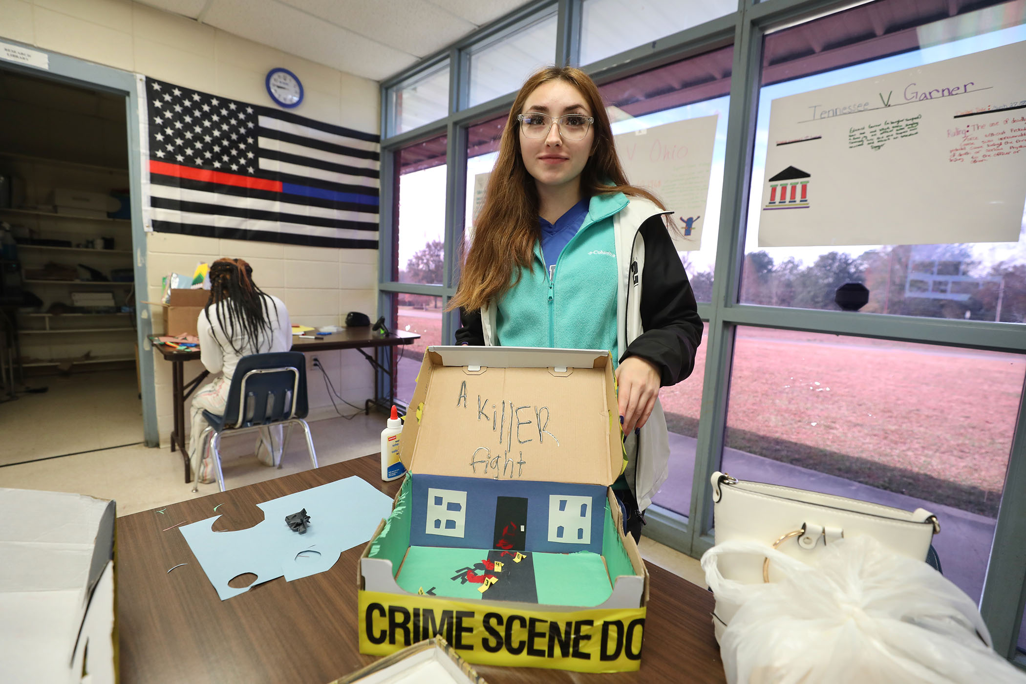 A students shows the work she has done for her CCCTC class.