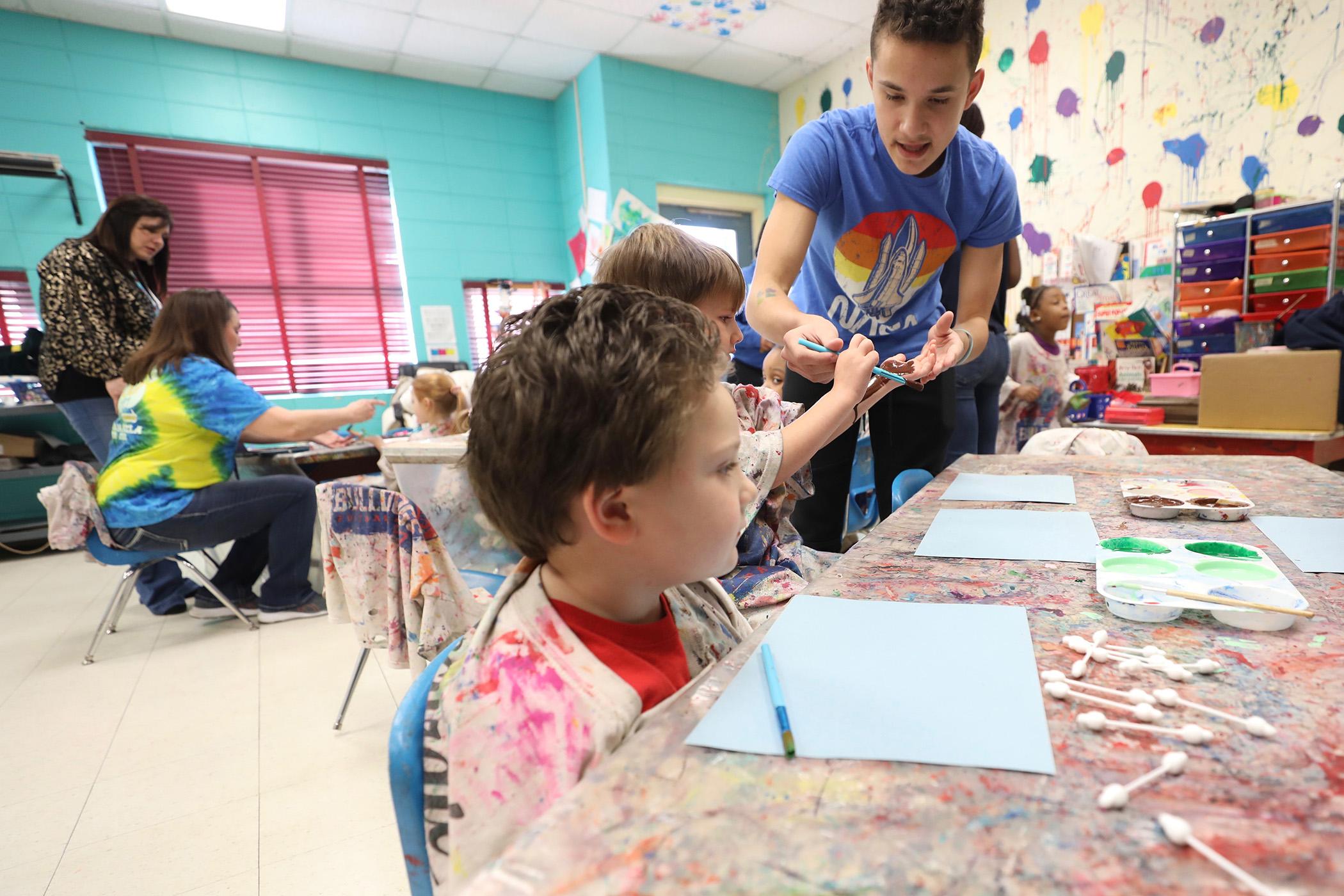 QLE kids enjoy an art project provided by FCCLA members.