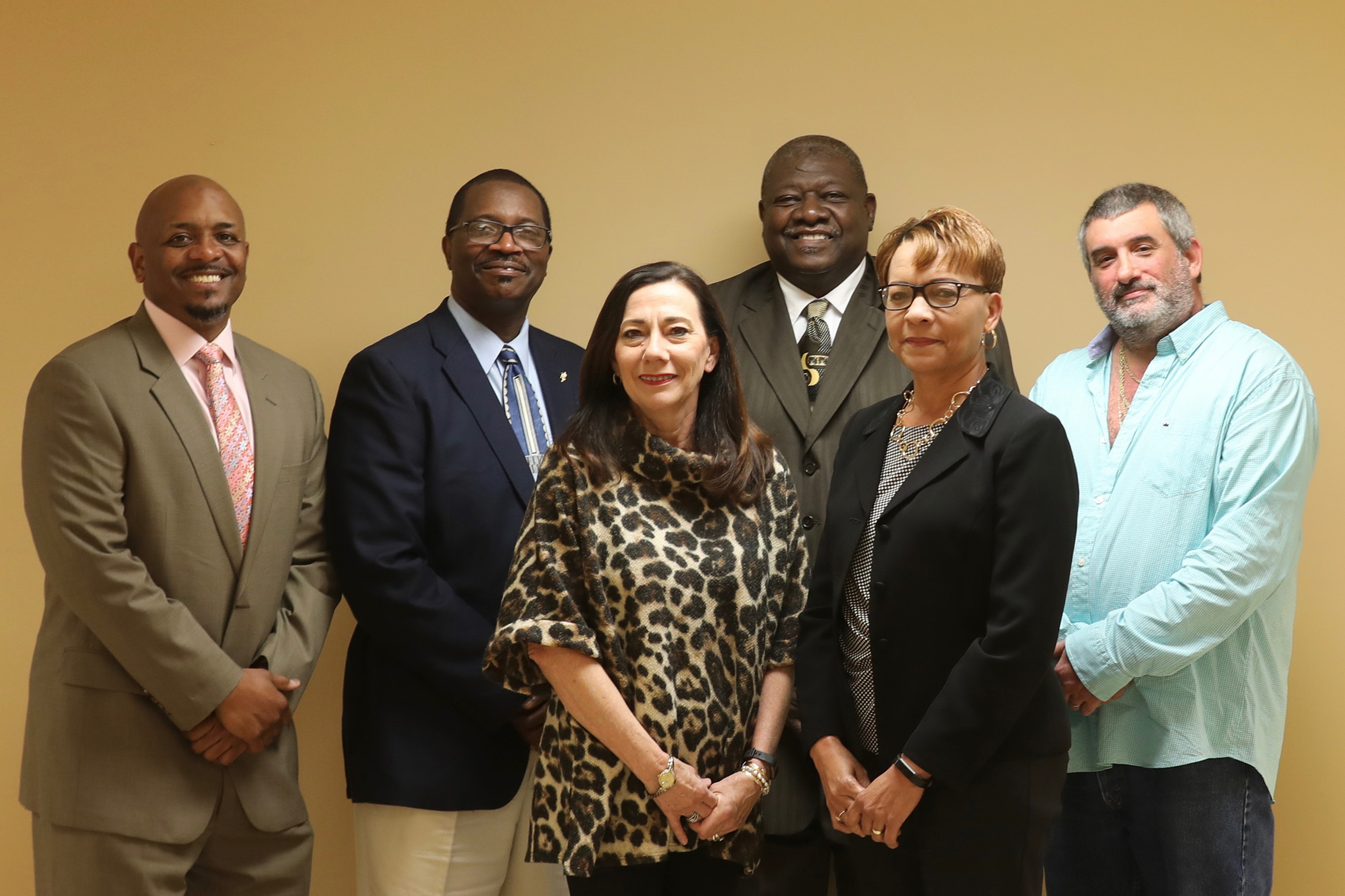 The Quitman School District School Board of Trustees poses with Dr. Holloway.