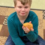 A SWAT student poses with a kindness rock.