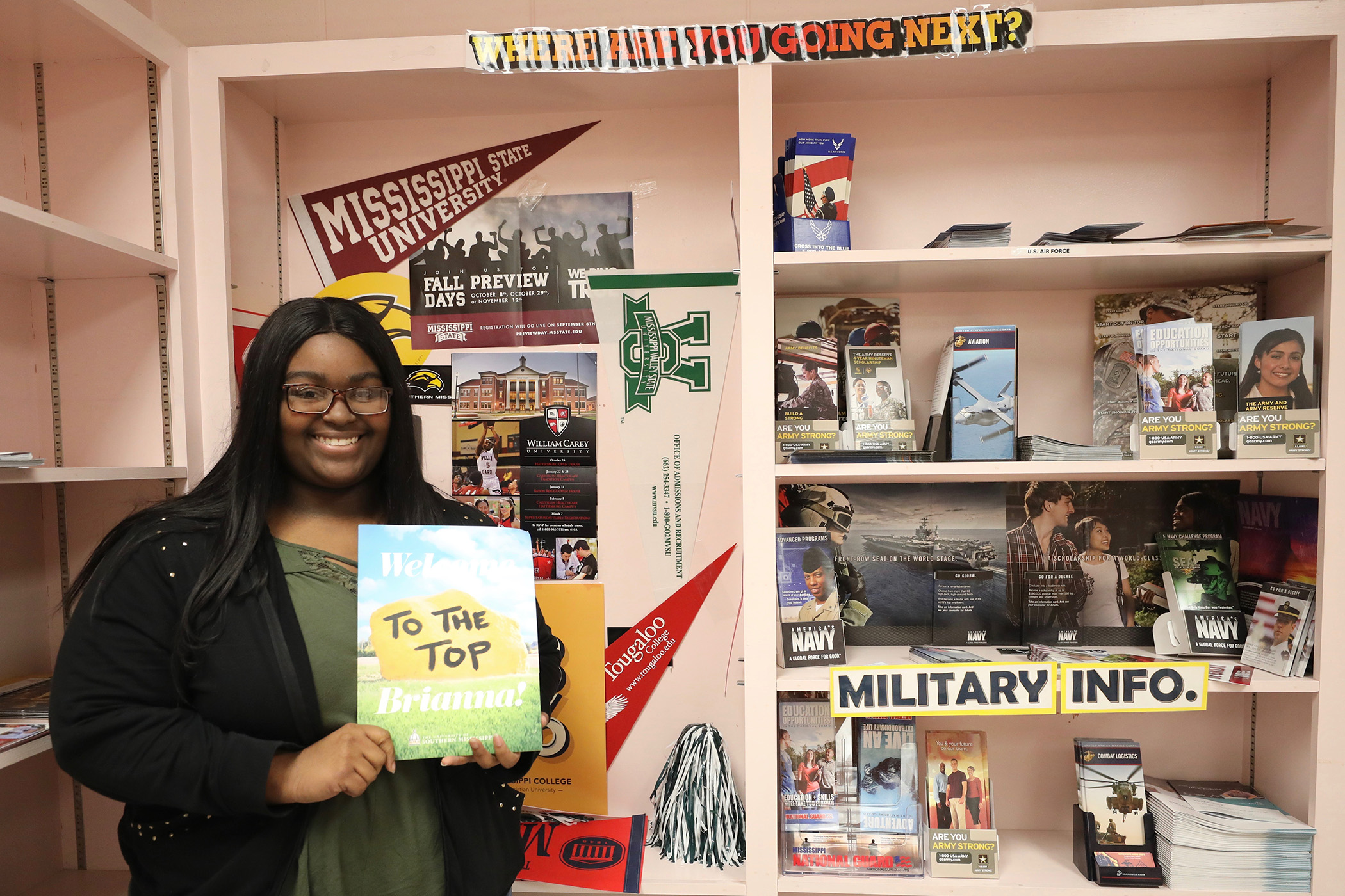 Brianna poses with a University of Southern Mississippi brochure.
