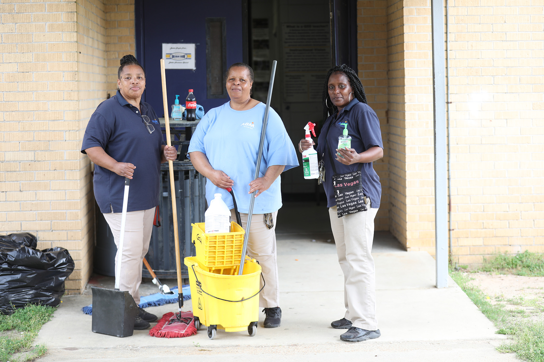 School custodians stop to pose for a photo.