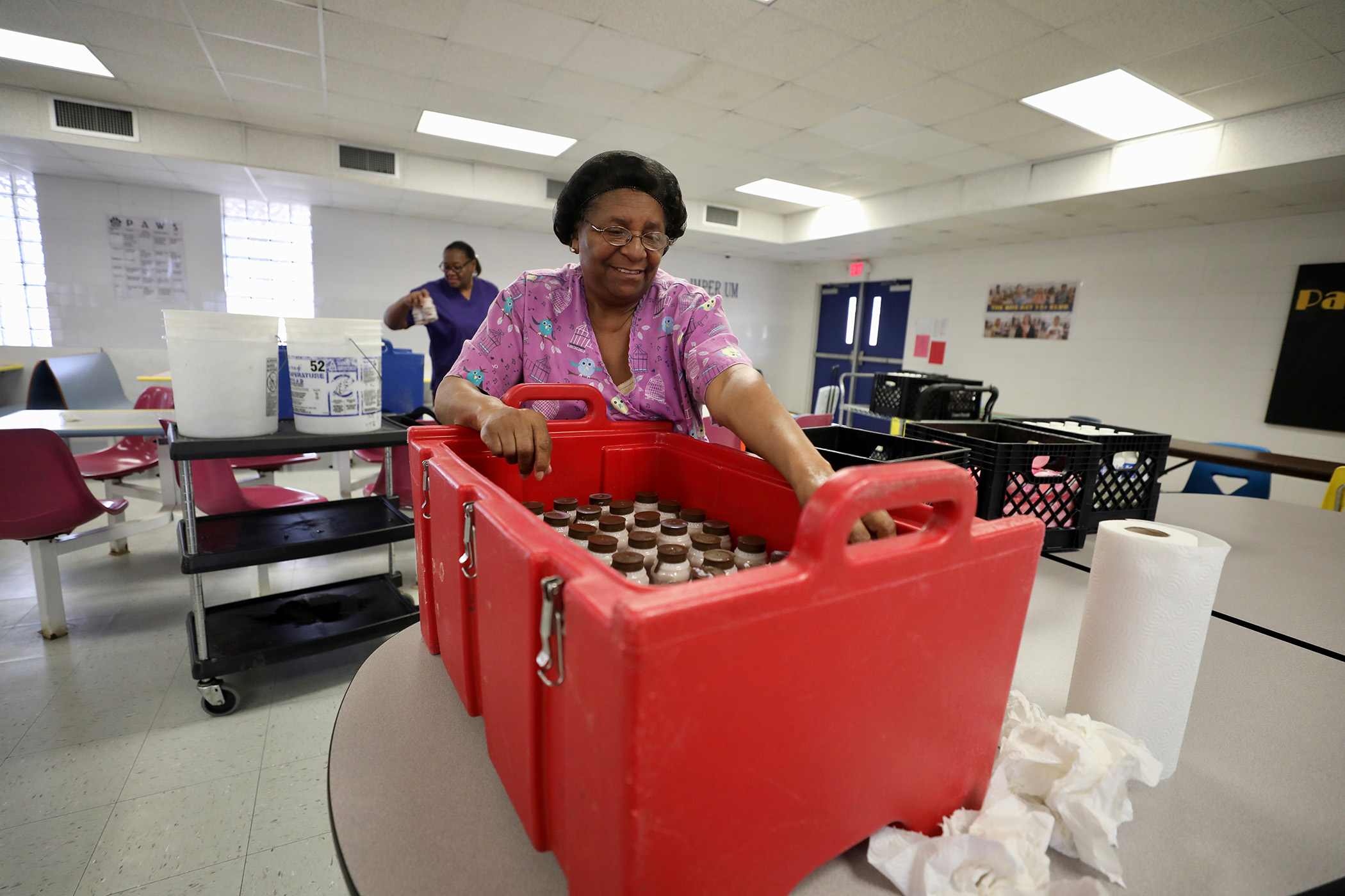 A QHS lunch lady prepares the coolers for the community outreach lunch program.