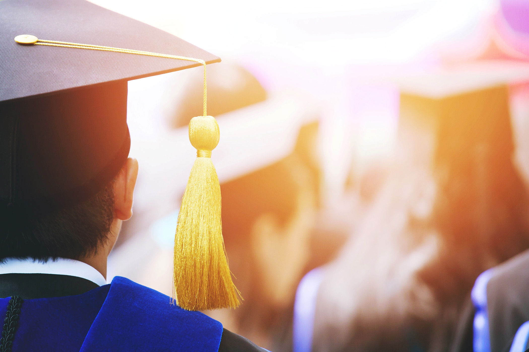 This is a stock photo of a graduate during a ceremony.