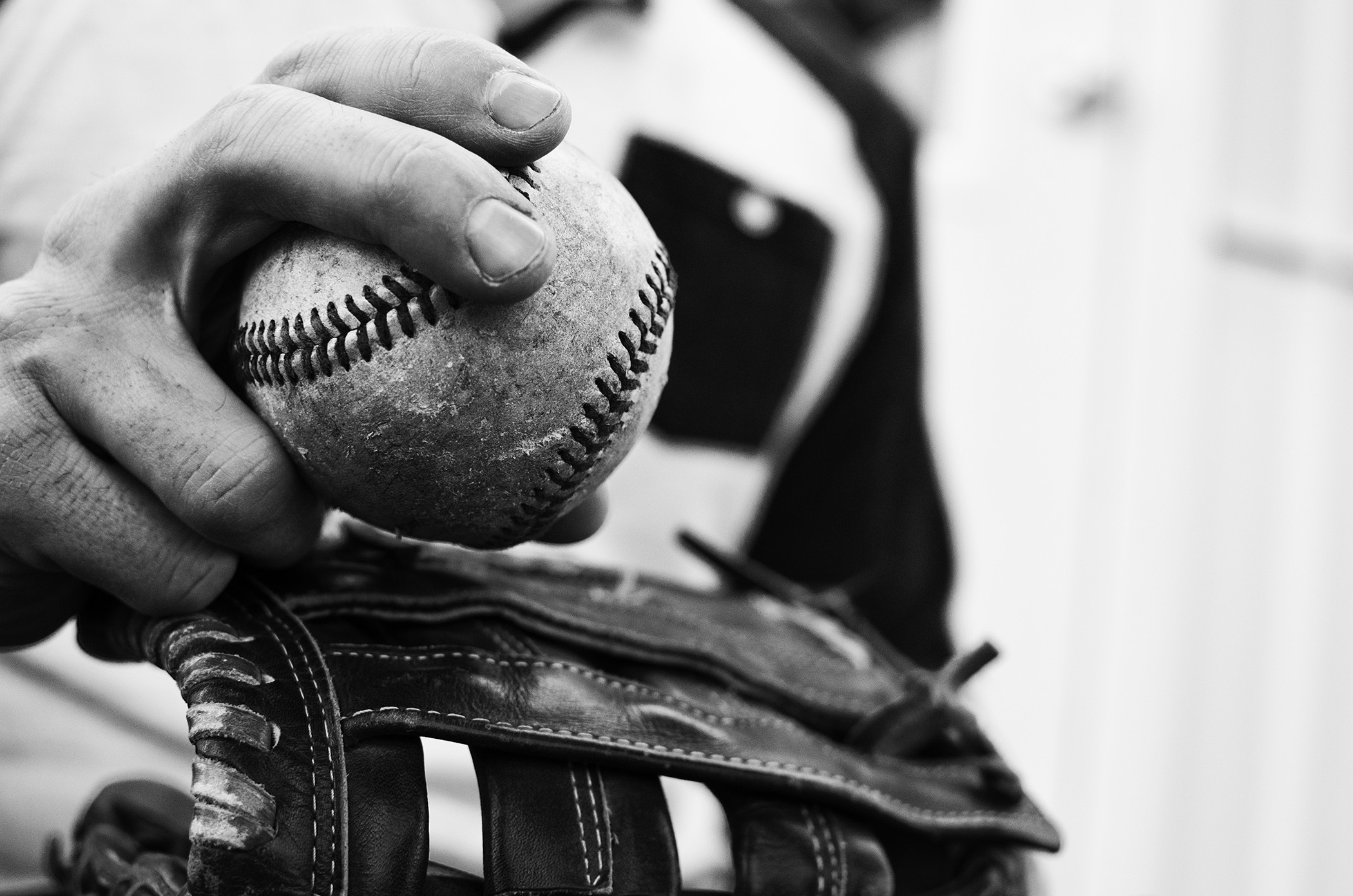 This is a screenshot of a guy holding a baseball.