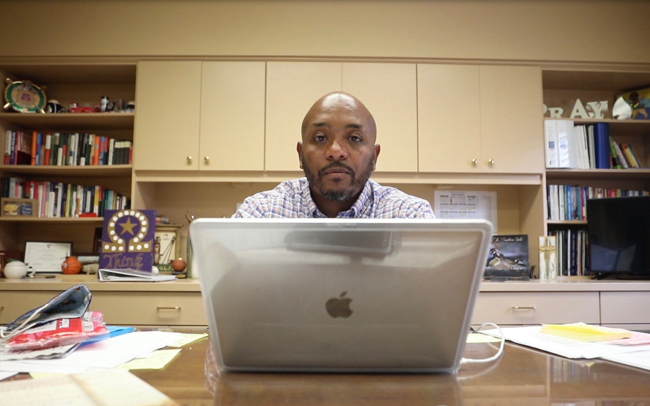 Dr. Holloway sits at his desk and speaks with Panther Nation.