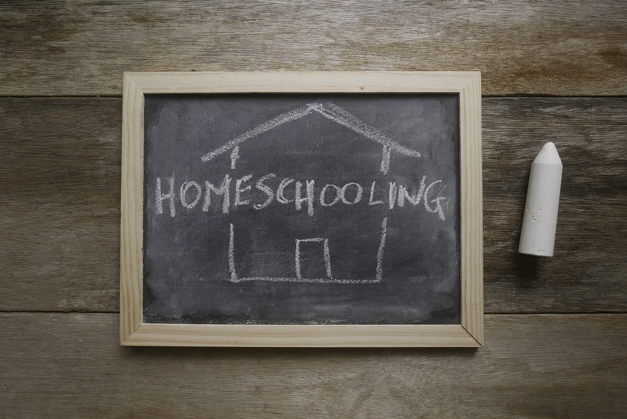 This is a chalkboard with the word homeschooling on it.