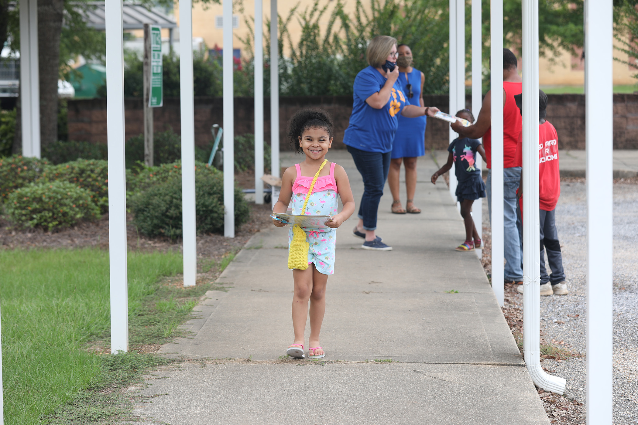 A QLE student picks up her free book pack.