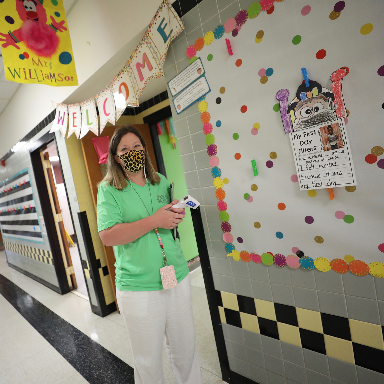 QLE kindergarten teacher Mrs. Williamson waits for her students to get to school.
