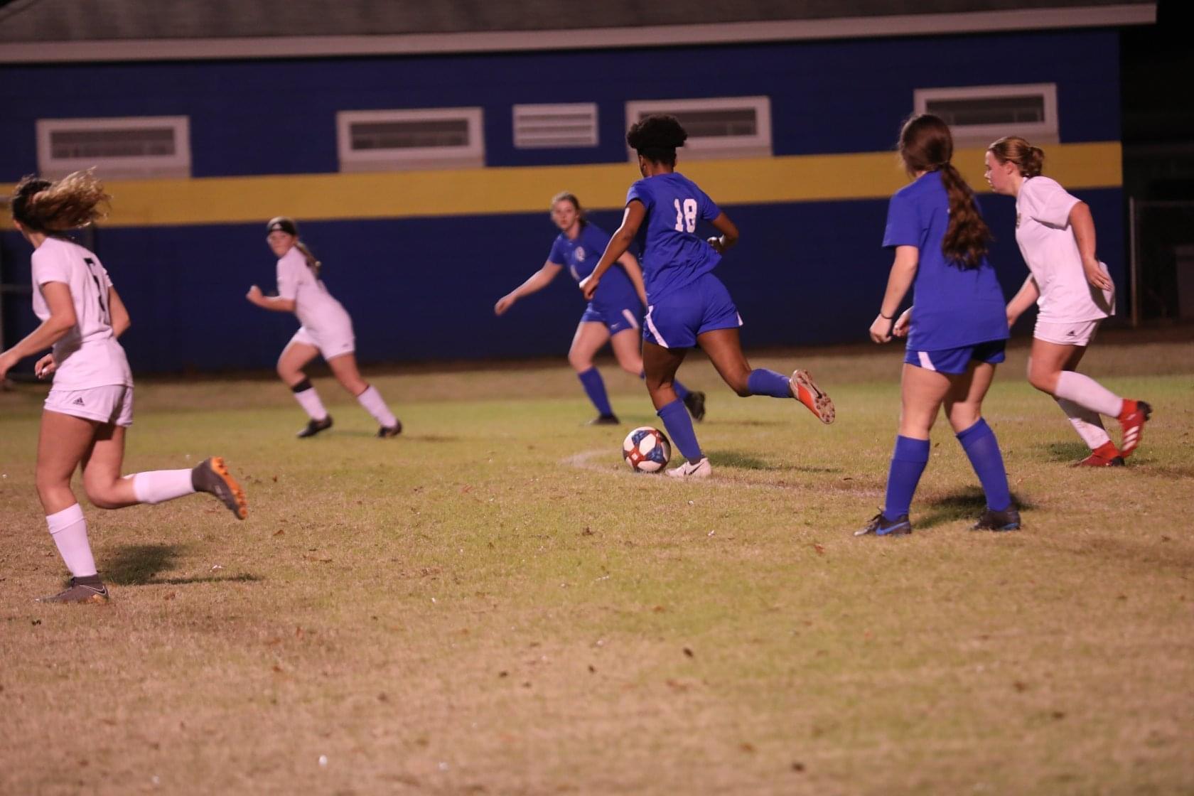 Sh'Carla plays soccer.