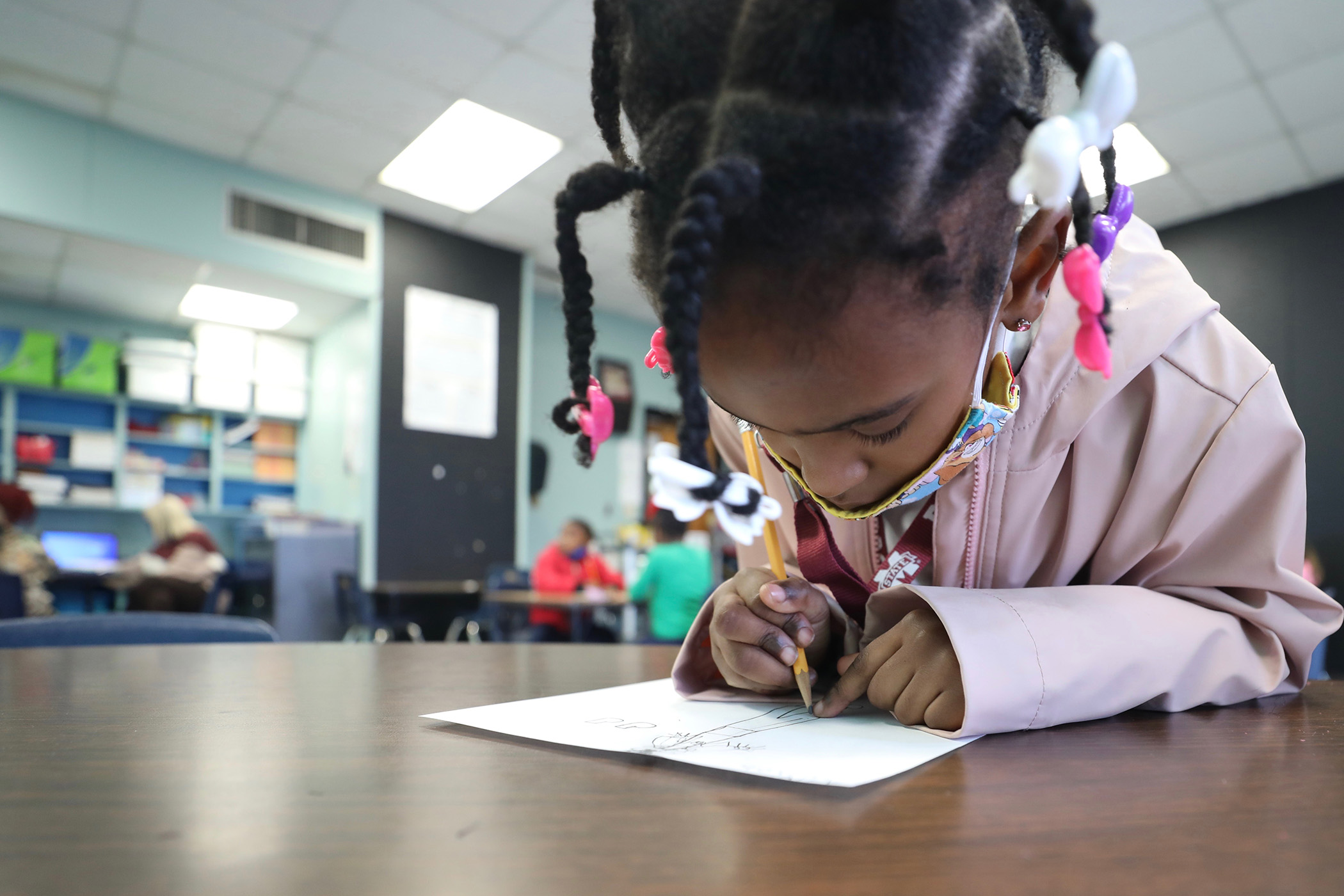 QLE art student focuses on her work.
