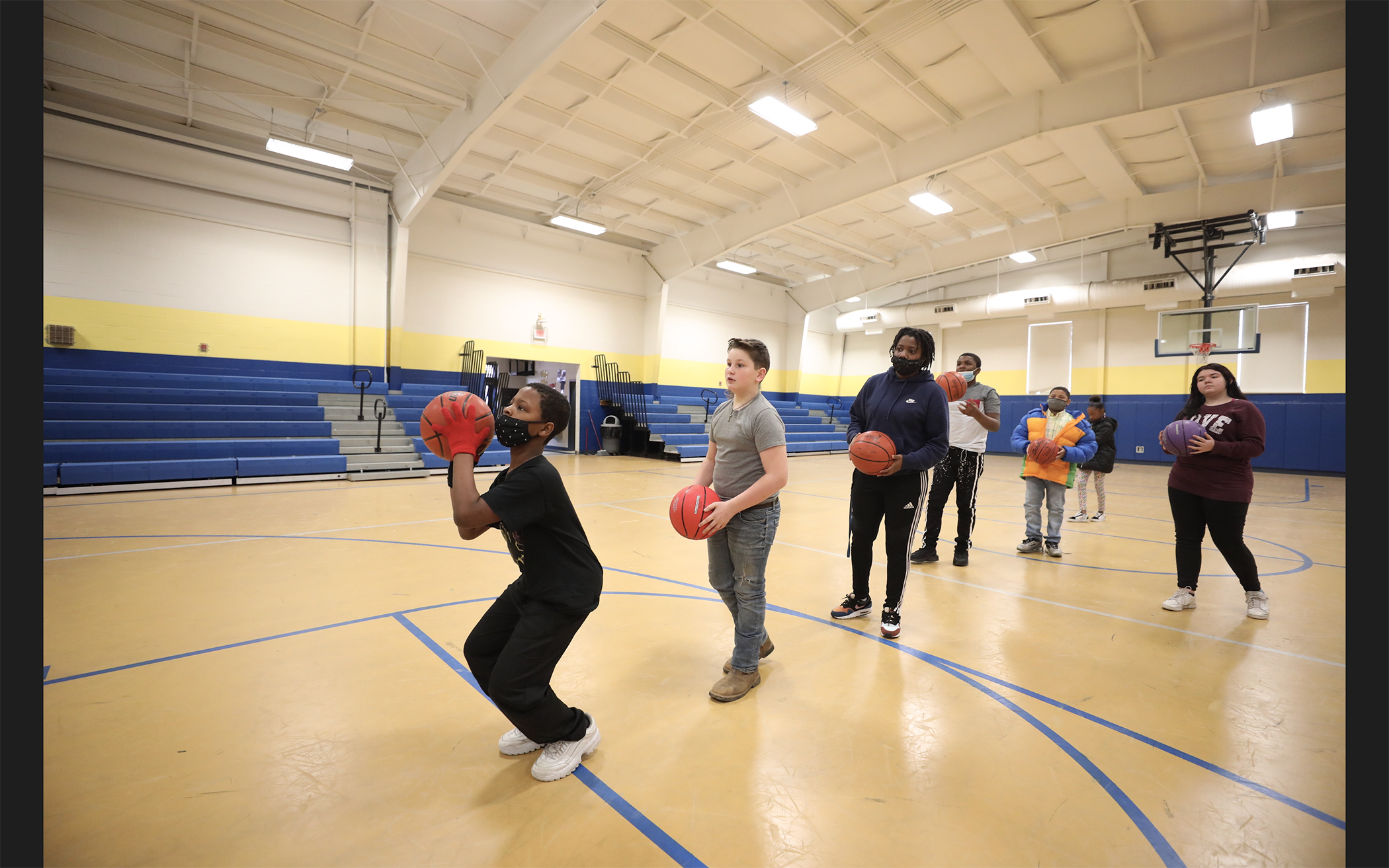 Shonte Hailes plays basketball with the students in Mrs. Hampton's PE class.